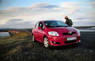 a guy talks about their automobile on the Ring Road and considers Iceland car leasing strategies for a travel tale.